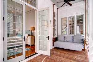 Rosemary Beach house master bedroom with wooden porch swing
