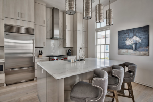 Alys Beach house kitchen counter seating with fun lighting
