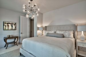 Alys Beach house guest bedroom with custom glass lighting