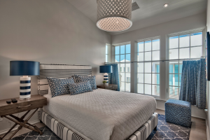 Alys Beach house guest bedroom with unique basket light fixture
