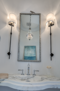 30A beach house bathroom with silver bird mirror