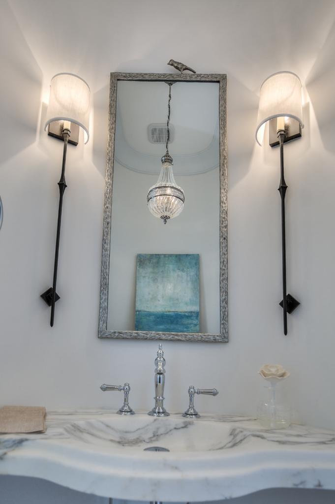 30A beach house bathroom with silver mirror